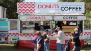 Donut And Coffee Van In Busy Market Location